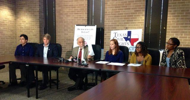 Jim Harrington (middle) argues against current voter registration procedures.