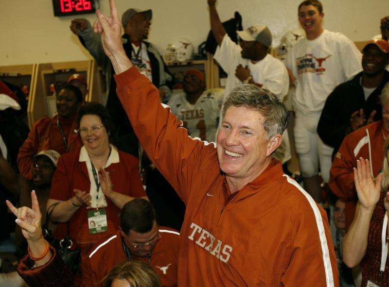 Mack Brown celebrates winning the 2005 national championship over the University of Southern California.