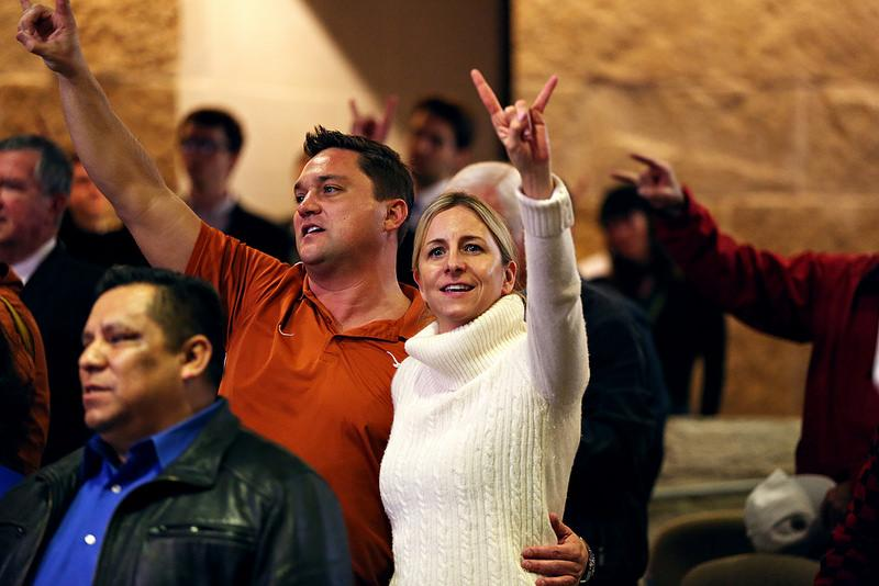 "Susannah Mcmahan and Troy Jordan sing along to the ""Eyes of Texas"" during a ceremony proclaiming January 30th as ""Mack and Sally Brown Day."" ""I've been a UT football fan since I was in diapers."" Mcmahan said."