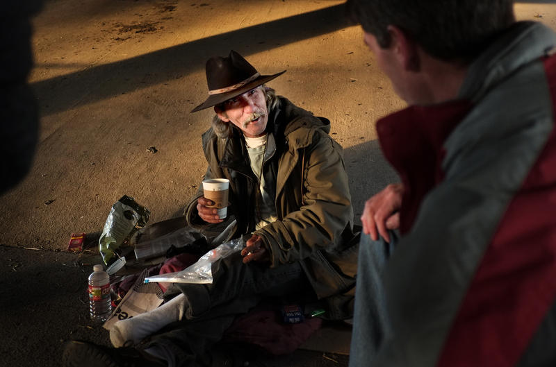 "Tivas, a homeless man who lives under the RM 2222 and Mopac Expressway overpass, jokes with ECHO team leader Edward McHorse. A federally mandated ""point in time"" count of Austin's Homeless takes place each  January."