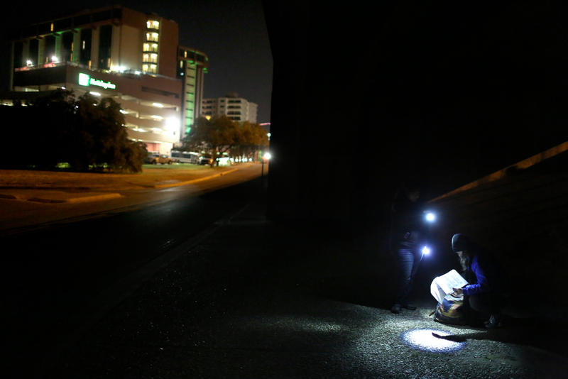 ECHO team leader Bree Williams registers a homeless man whom they identified under the I-35 overpass at Lady Bird Lake.