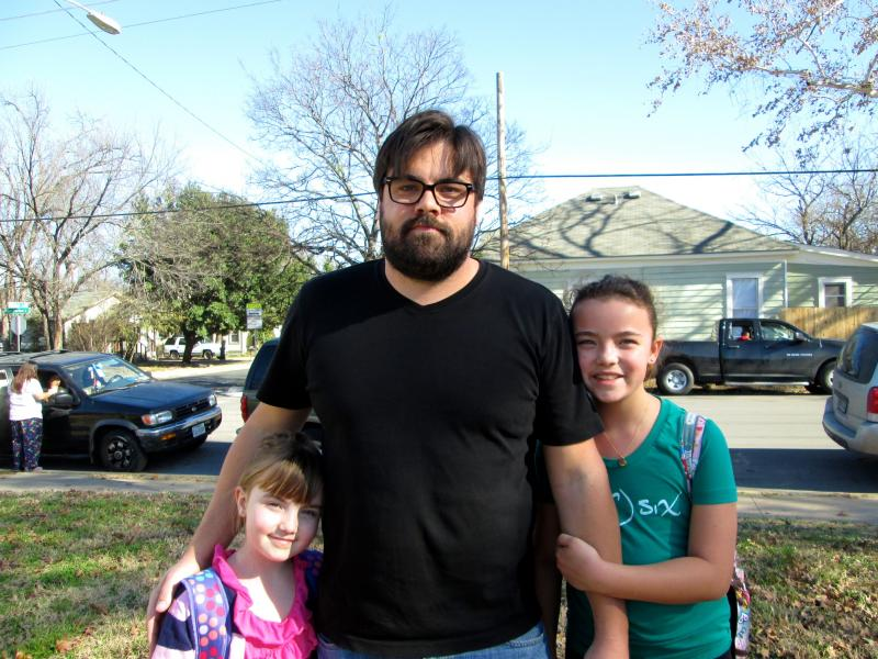 Luke Muszkiewicz with his daughters, Margot (left) and Hannah. Muszkiewicz and his wife transferred his daughters to Metz Elementary, a school that has seen declining enrollment over the last decade.