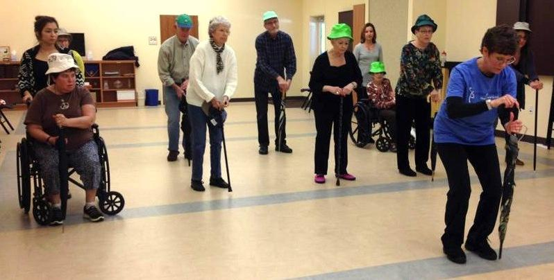 At a Power for Parkinson's class, patients stay active by dancing to the music of 'Singin' in the Rain.'