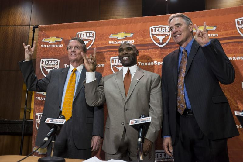 UT President Bill Powers and Athletic Director Steve Patterson welcome Charlie Strong to the 'Longhorn family' on Jan. 6, 2014.