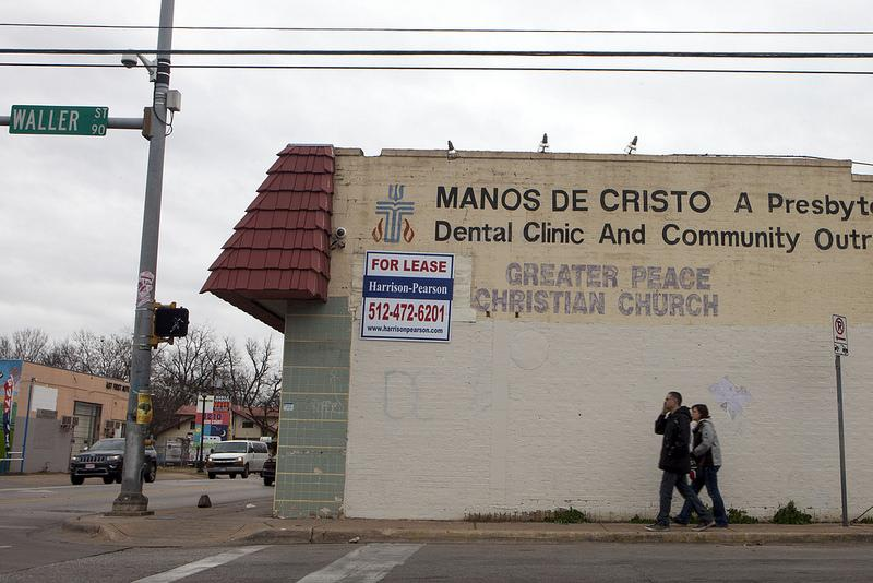 Philip Montoya, 40, and Sunshine Price, 41, both of Austin, walk in front of the Manos de Cristo Dental Clinic on the Tejano Healthy Walking Trail in East Austin.