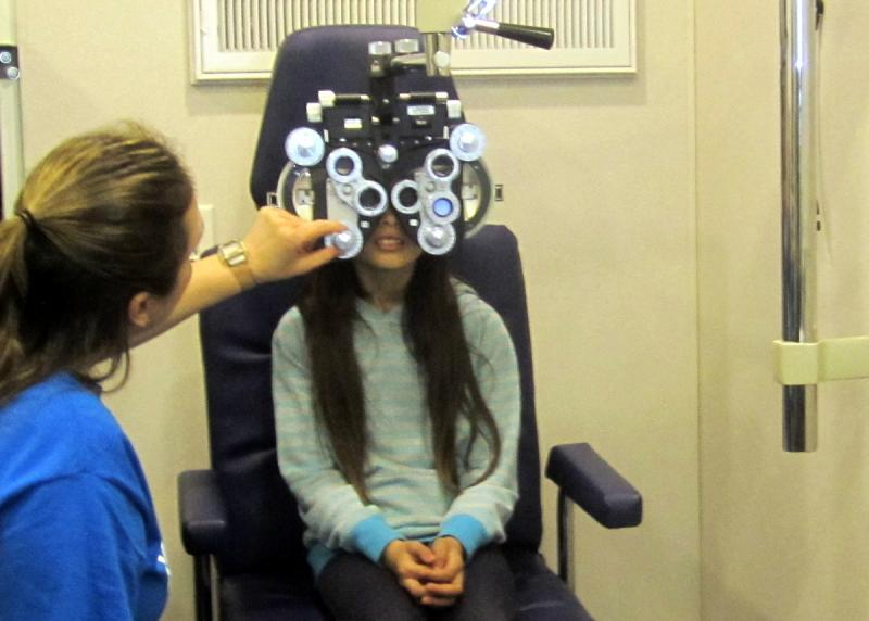 A Perez student is screened before receiving her new glasses.