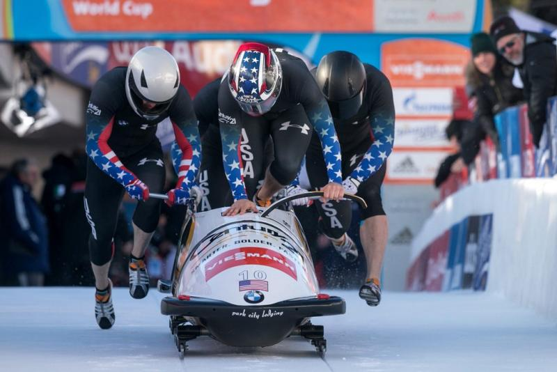 Nick Cunningham, Justin Olsen, Johnny Quinn and Dallas Robinson from the USA start in the first run of the four-man bobsleigh World Cup in St. Moritz, Switzerland, 12 January 2014. Olsen and Quinn both hail from Texas.