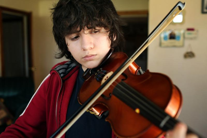 Isay Medrano's absences to care for his ill mother put his school orchestra playing into jeopardy.