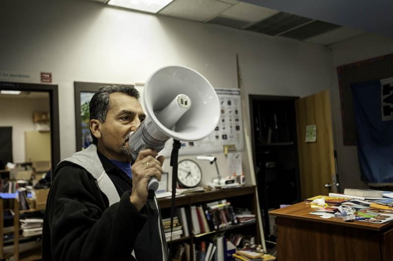 "Librarian Cervantes uses a megaphone during ""Morning Club,"" Feb. 19, to remind students that breakfast will be served in the cafeteria."
