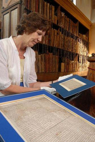 Hereford Cathedral archivist Rosalind Caird examines the Magna Carta in