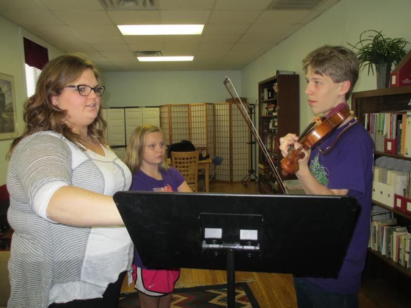 Violinists Lizzy Jones, center, and Chet Fagerstrom, left, are sure their futures will include music even if it's not in the form of a career.