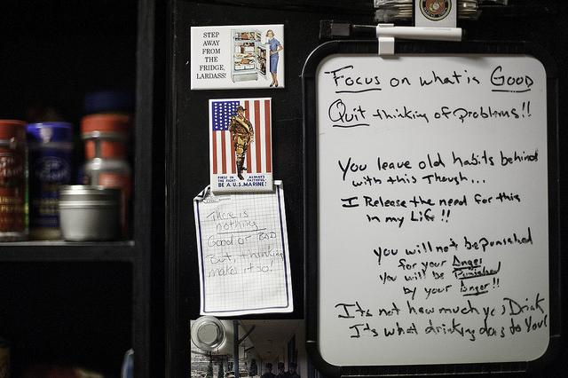 Inspirational messages are written on a dry-erase board on a resident's refrigerator.