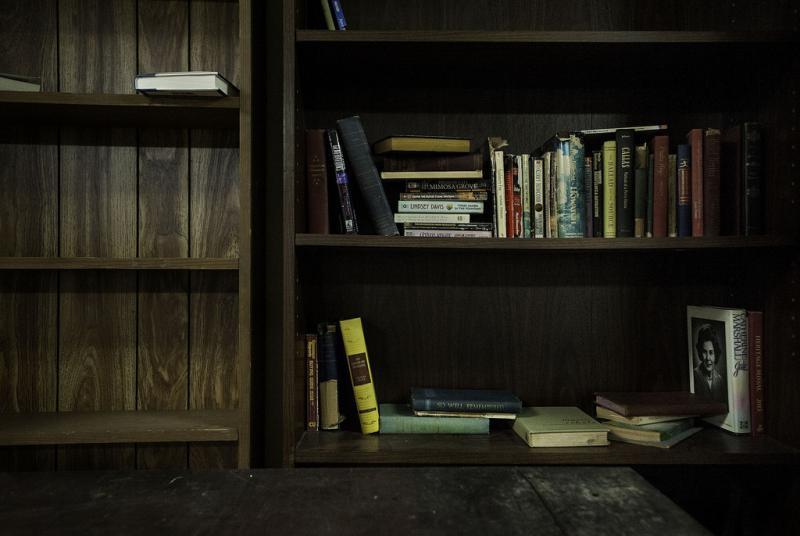 A bookshelf in the facility's communal room.