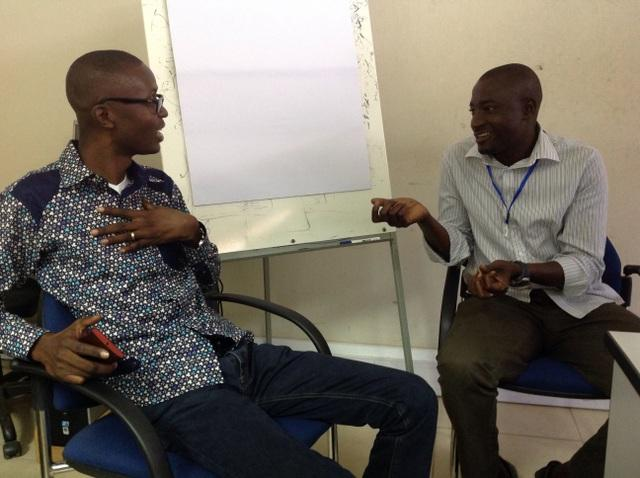 Citi FM Director of News Programming Bernard Avle (left) practices interviewing skills with a young journalist at a workshop.