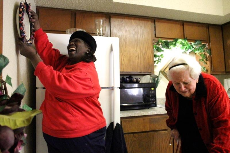 Henrietta City, left, helps Betty Finn at her apartment in Austin on Feb. 12, 2014.