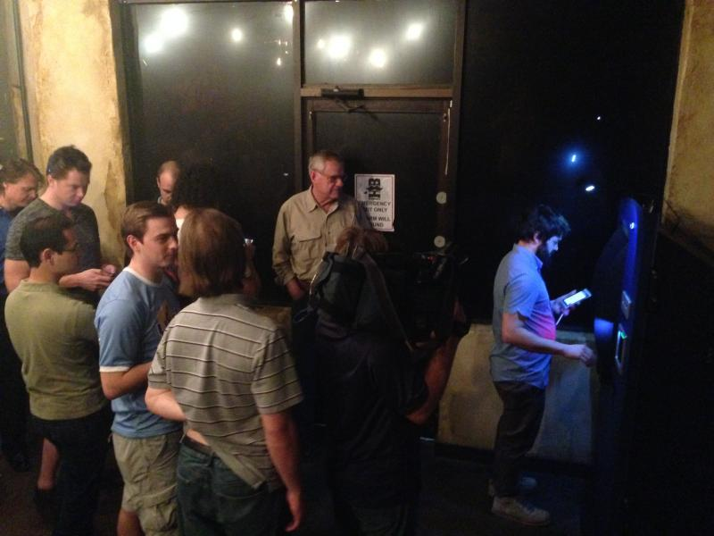 People line up to use Austin's first Bitcoin ATM. The Robocoin machine is located at Handlebar on East 5th Street.