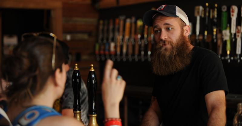 Craft Pride general manager David Voss answers a customer's question. The bar did not participate in any SXSW-related events this year.