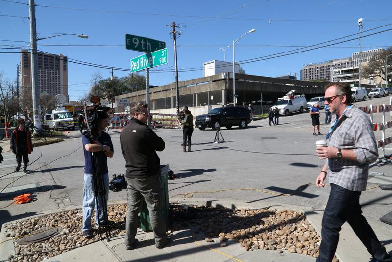 Press and festival-goers mix at Ninth and Red River Streets after Thursday's press conference.