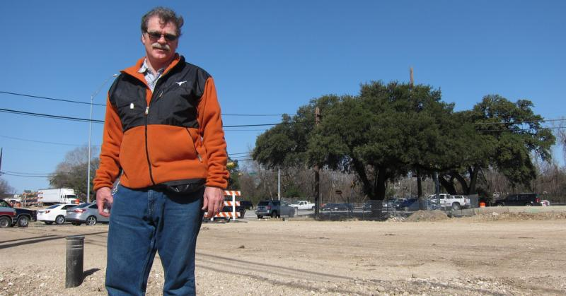 "Michael Fossum with the Austin Heritage Tree Foundation stands in front of the heritage Live Oak known as the ""Taco Bell Tree."" Fossum and his group fought to save the tree from being cut down for a traffic project."