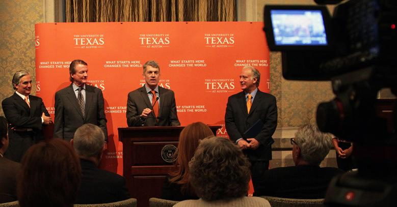 Dr. Clay Johnston (center), speaking after being named inaugural dean of the Dell Medical School.
