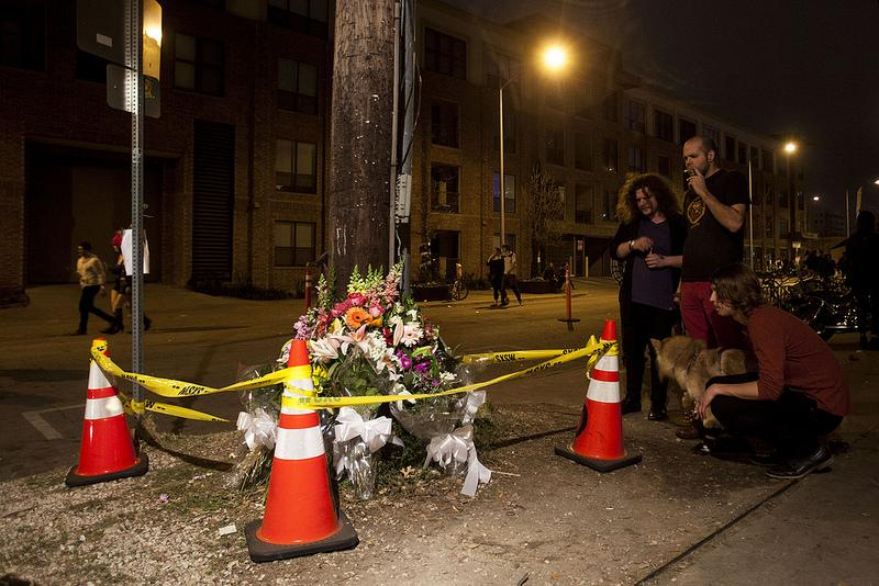 Onlookers at a memorial in front of The Mohawk honoring victims of a crash outside the club earlier that week.