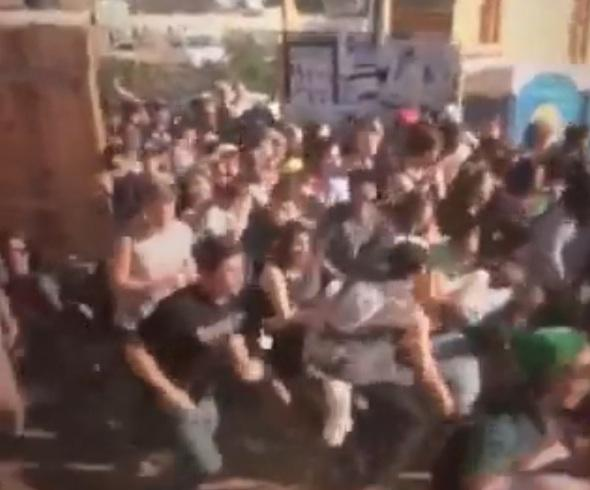 This image from a video released by APD allegedly shows fans breaking through the gates at the Scoot Inn on Thursday March 13th, 2014.