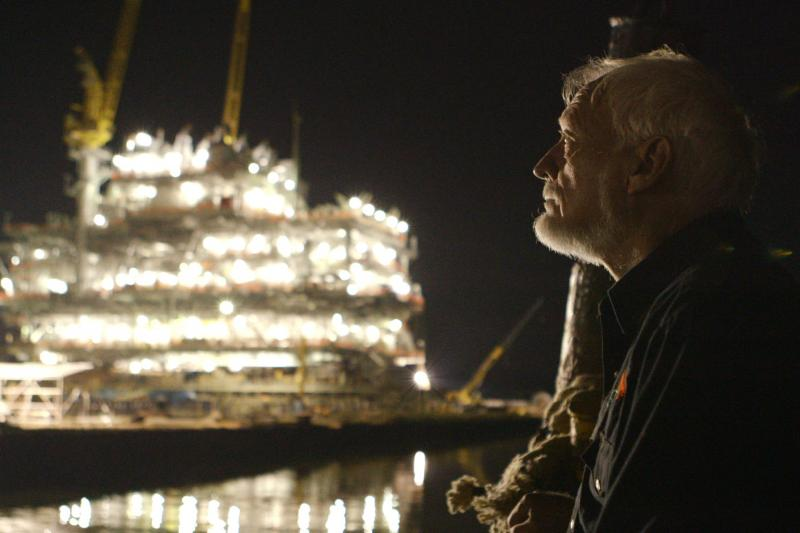 "Latham Smith, a tugboat captain who works for the oil  industry, is featured in ""The Great Invisible."""