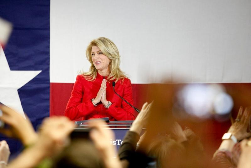 State Sen. Wendy Davis, D-Ft Worth, takes the stage as supporters at her Fort Worth headquarters cheer her victory in the primary election.