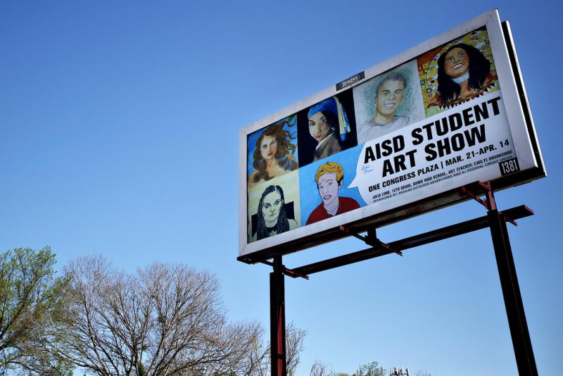 This billboard, off of Montopolis road, was designed by Bowie High School senior, Julia Lund. In celebration of Youth Art Month, AISD held an art contest in which the winner was allowed to design 10 billboards around Austin.