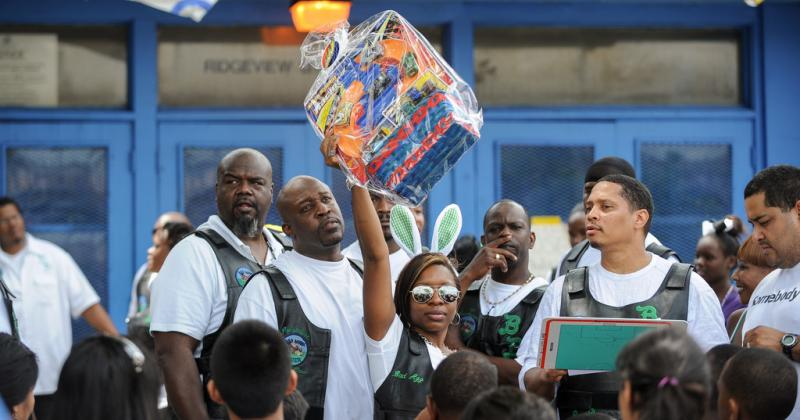 Tamara Pruitt holds up one of several Easter baskets given away during the Bad Boyz and Girlz 4 Ever Motorcycle Club's raffle.