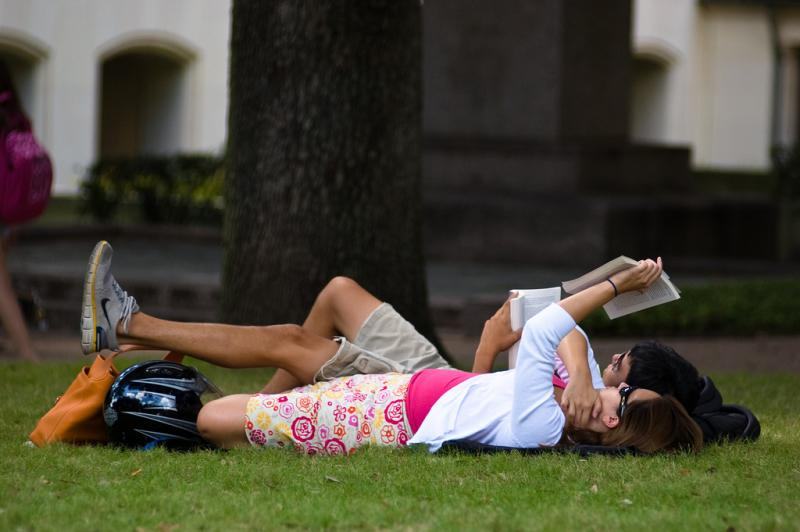 "UT-Austin students stretch out between classes in this undated 2010 photo. Over 100 UT faculty members signed a letter this week opposing the university's proposed ""shared services"" model."