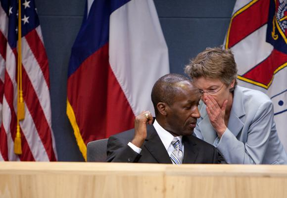 Austin City Manager Marc Ott gets a message from former Chief Financial Officer Leslie Browder in this 2011 photo.
