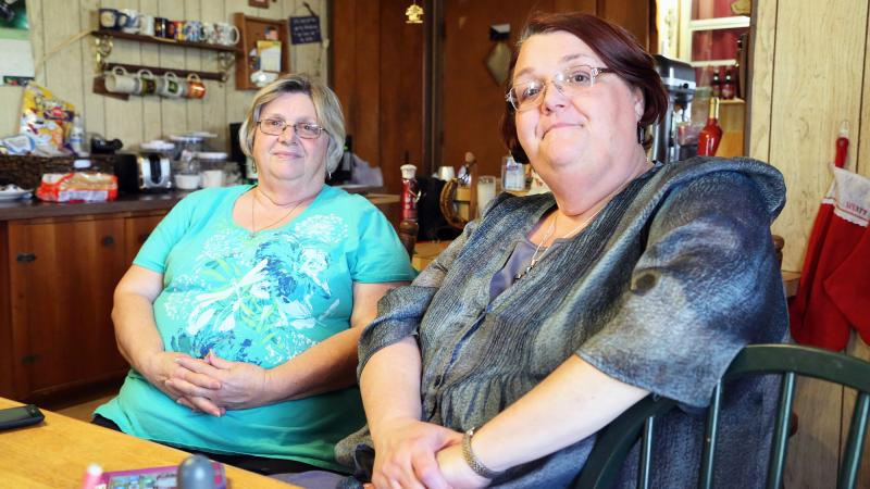 Loretta Volcik and her sister, Jeanette Holecek(L) sit at Volcik's home in West, Texas. Holocek and her husband, James, have lived with her sister since she lost her house in the explosion.