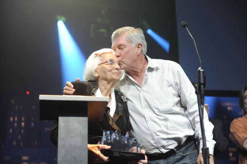 Edith Royal and Mack Brown celebrate Darrell Royal's induction in the Austin City Limits Hall of Fame.