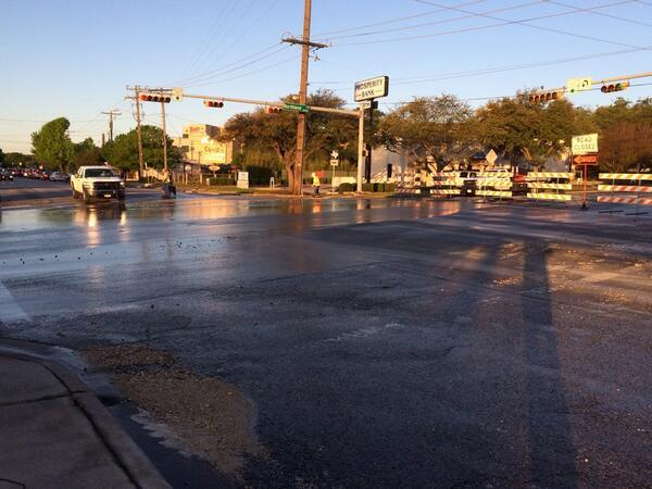 Some collapsed portions of the road are visible in this newer photo of the scene, tweeted by Austin Water.