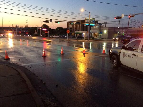 An early scene of the water main break at 2222 shows water on the roadway.