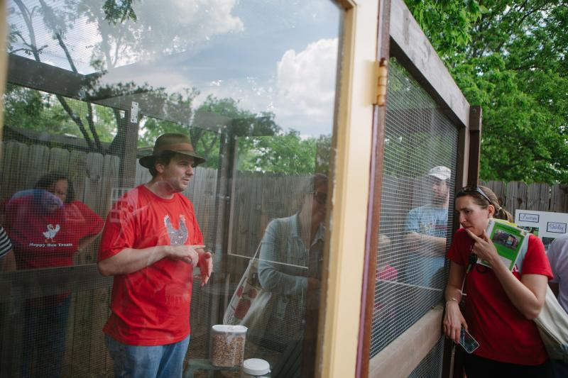 Naji Norder, 37, explains his chicken coop, which was built from scratch, at his home on Montview Street.