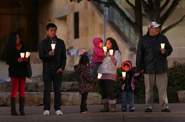 A candlelight vigil for victims of Typhoon Haiyan that devastated parts of the Philippines was held at City Hall on Tuesday Nov. 26, 2013.