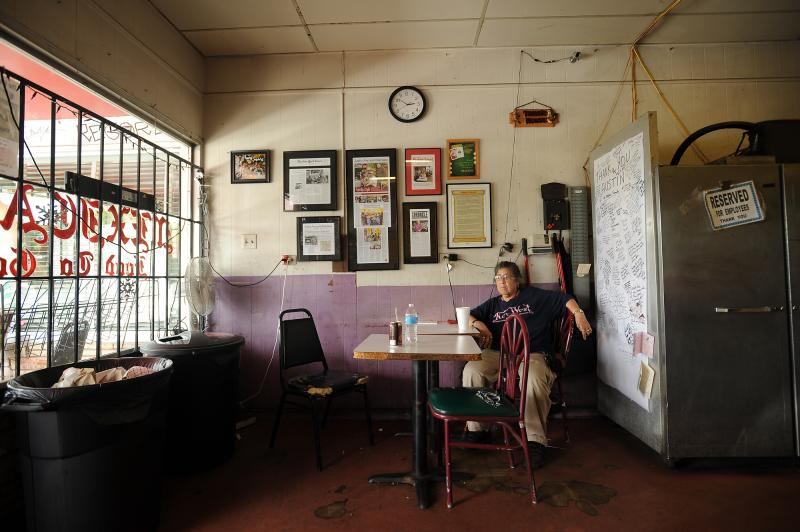 "Connie Salazar, the long-time companion of owner Robert Vasquez, sits quietly on the final day at Tamale House #3 on Airport Blvd. Tamale House will close in the wake of Vasquez's death. ""Everybody misses the place,"" she said, ""I'm going to miss him too."""