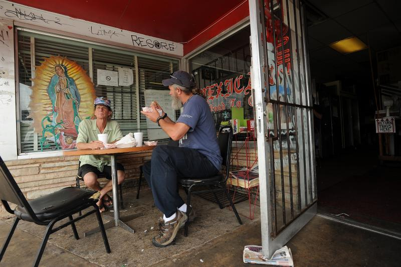 Mark Mills and Will Hyatt, who have been eating at Tamale House since the mid-1980's, eat one last meal during the final day at Tamale House #3 on Airport Blvd. Tamale House will close in the wake of owner Robert Vasquez's death.