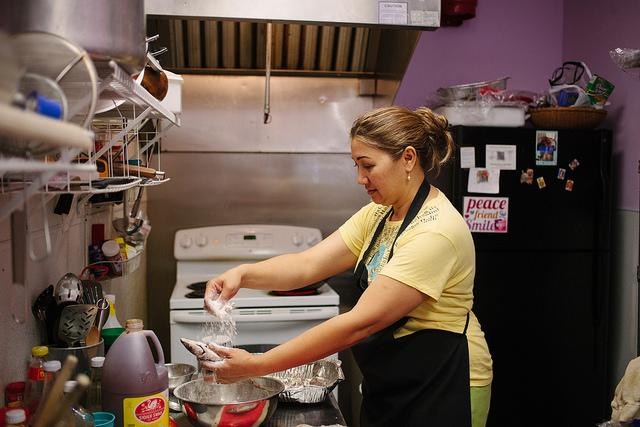 Jing Franklin, owner of Filipino Asian Mart in South Austin, prepares lunch for her customers. Filipino Asian Mart is a hub of the Filipino-American community.