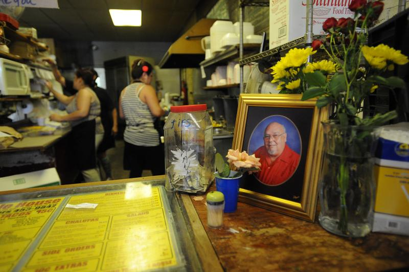 A memorial to owner Robert Vasquez is on display during the final day at Tamale House #3 on Airport Blvd. Tamale House will close in the wake of owner Robert Vasquez's death.