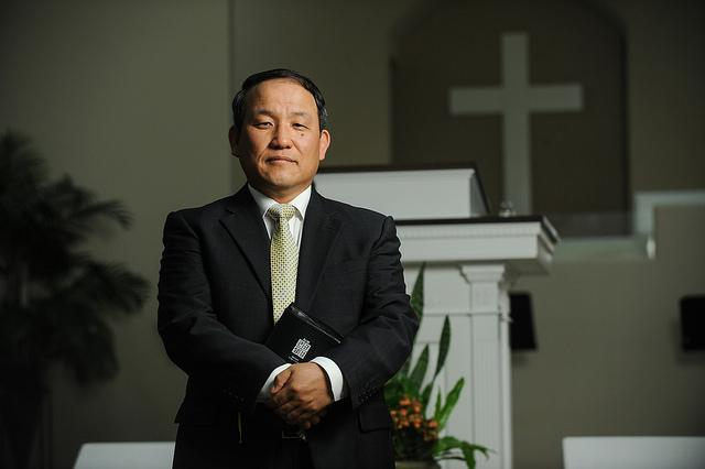 Pastor An poses for a portrait at the Praise Jesus Church on West Braker Lane. The congregation is primarily a Korean population in North Austin.