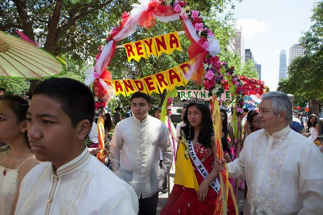 The Austin Filipino-American Association sponsors a Flores de Mayo celebration at the Texas State Capitol. Alex Lizarraga and Rica Nicolau, who is the Reyna Banderada, lead the procession.