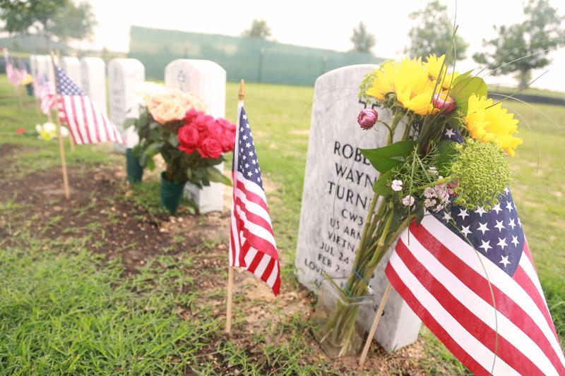 Families visited graves of loved ones at the Central Texas State Veterans Cemetery on May 26, 2014.