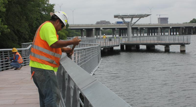 Daniel Olivera puts the finishing touches on the boardwalk.