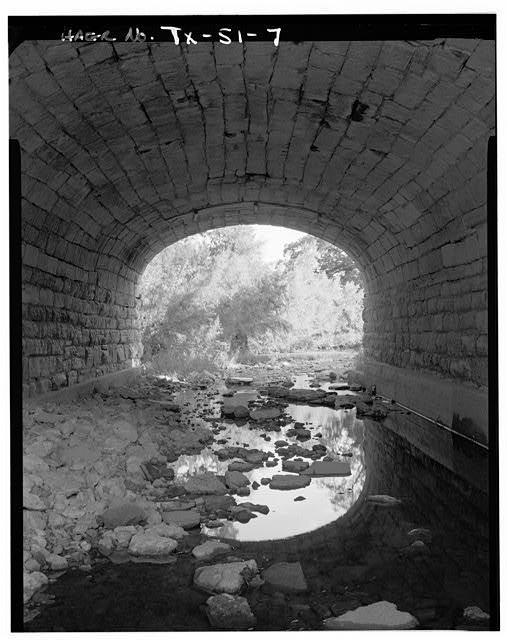 Under the interior arch of the bridge