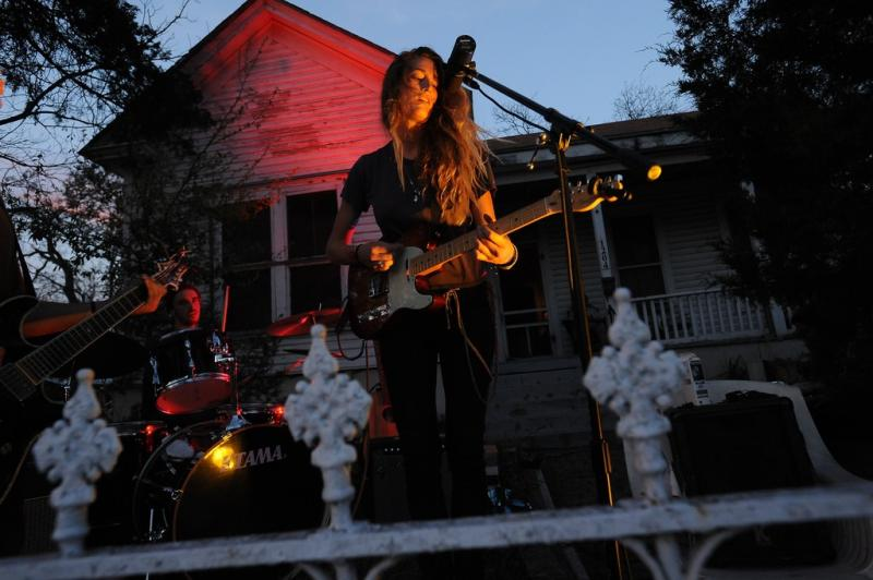 Rosechild, a band from California, performs in a front yard on E. Sixth during SXSW Music, Mar. 15. A post-event survey of SXSW has just been released.