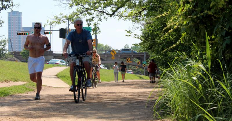 UT researchers singled out the shady trail around Lady Bird Lake as promoting healthy activity during summer.