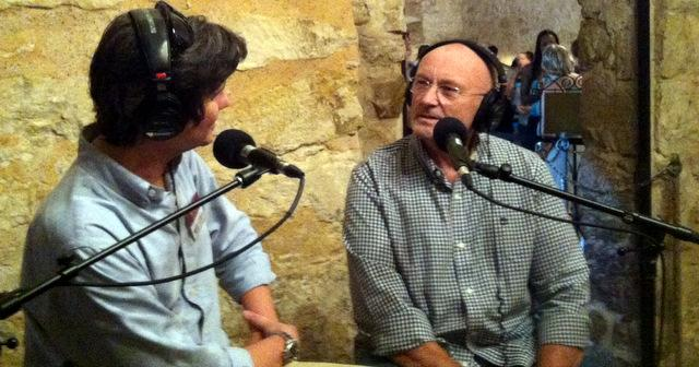 Rocker and Texas Revolution expert Phil Collins (r) talks with Texas Standard's David Brown in the Alamo.